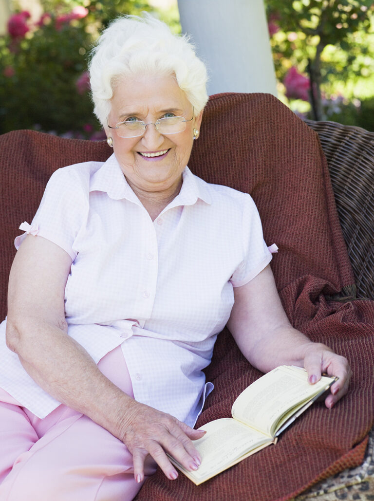 Greystone Senior woman reading book senior living