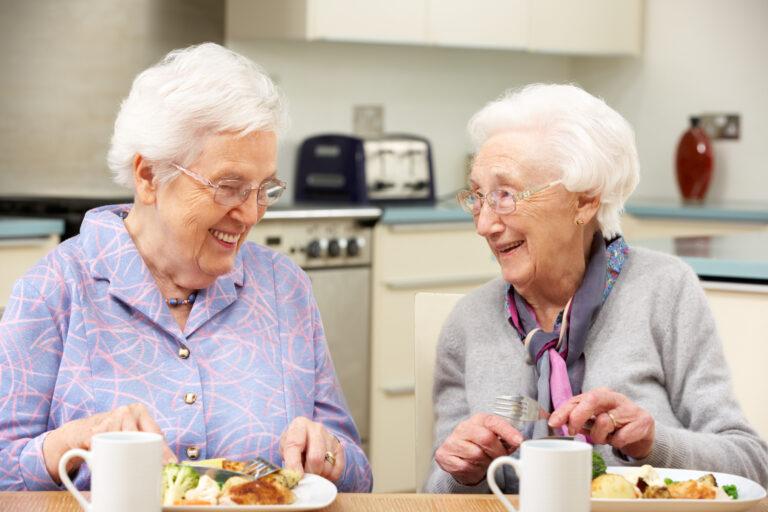 Senior women enjoying meal senior living