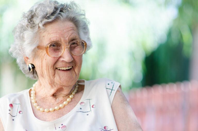 Senior woman smiling Greystone